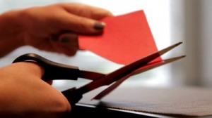 stock-footage-woman-cutting-out-a-red-paper-heart